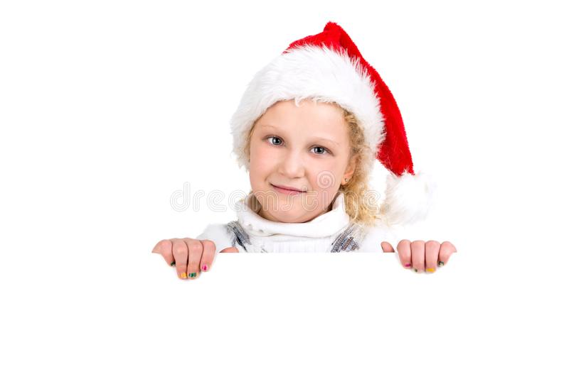Happy young girl with Santa`s hat stock photos