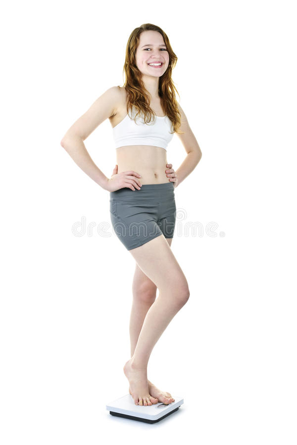 Download Happy Young Girl Standing On Bathroom Scale Stock Photo - Image: 19672266
