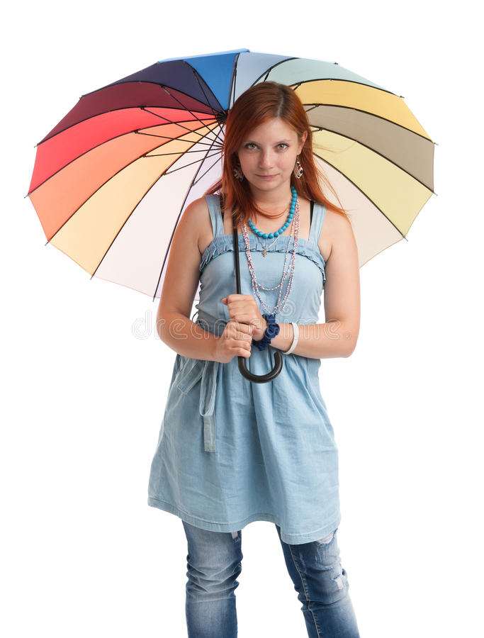 Happy young girl with an umbrella royalty free stock photos