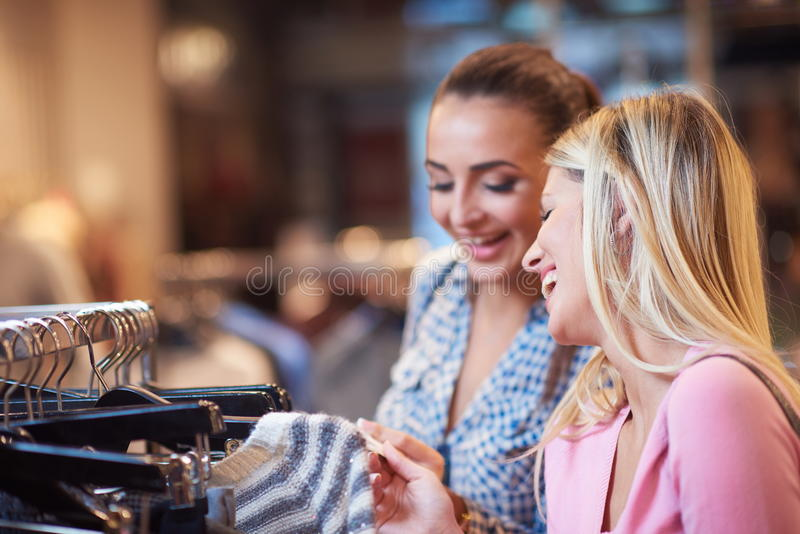 Happy young girls in shopping mall royalty free stock photos