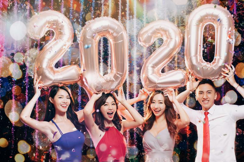 Young group celebrating new yew 2020 in christmas party royalty free stock photos