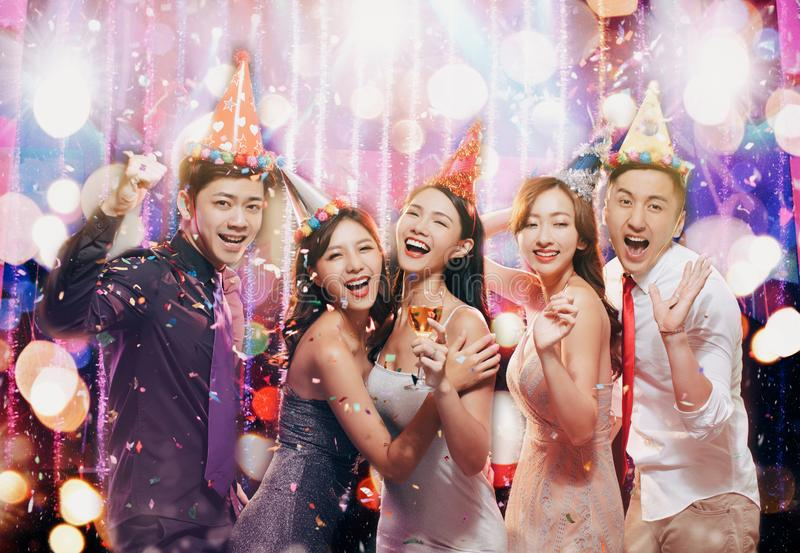 Young group enjoy birthday party in night club stock photo