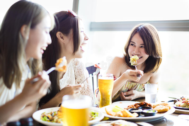 Happy young group enjoying dinner party royalty free stock photos