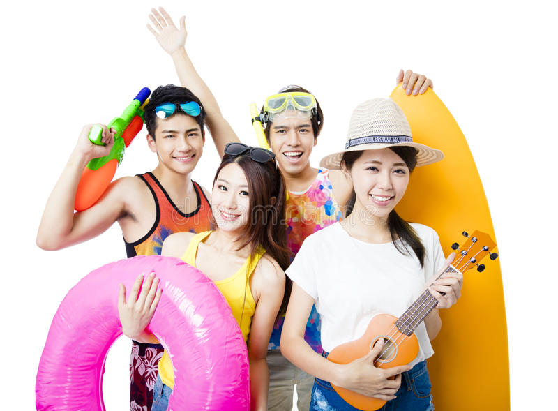 Happy young Group holding beach accessories stock photo