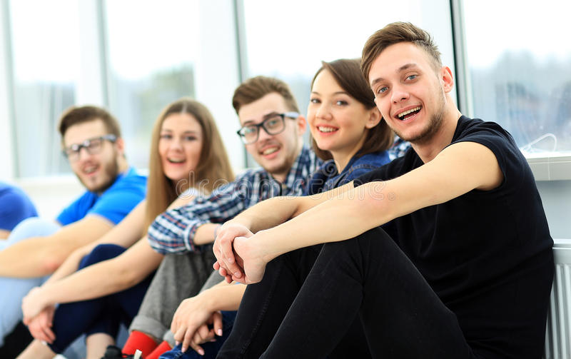 Happy young group of people standing stock image