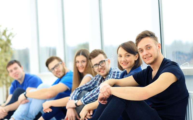 Happy young group of people standing stock photos