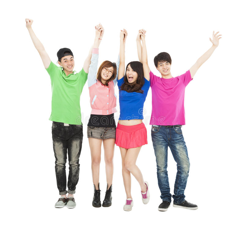 Young group standing with hands up royalty free stock image