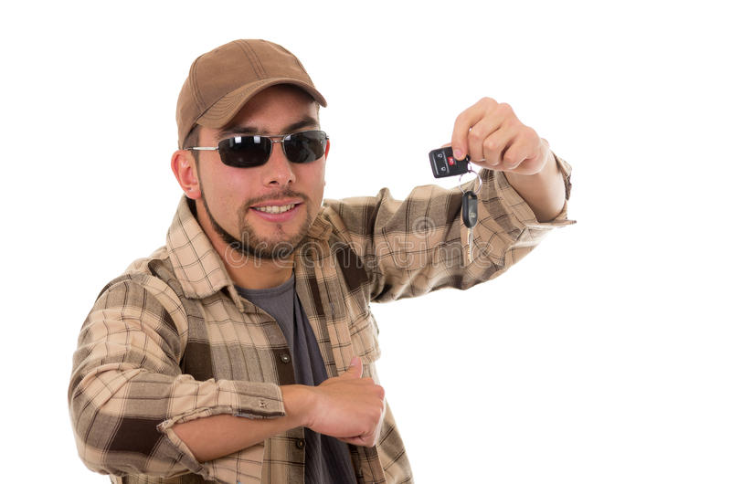 Happy young guy in flannel shirt and cap showing stock images