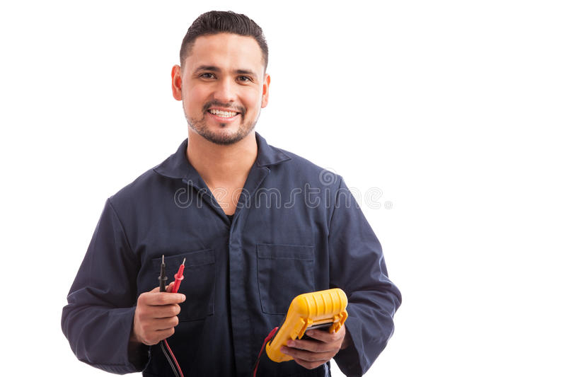 Happy young Hispanic electrician stock photo