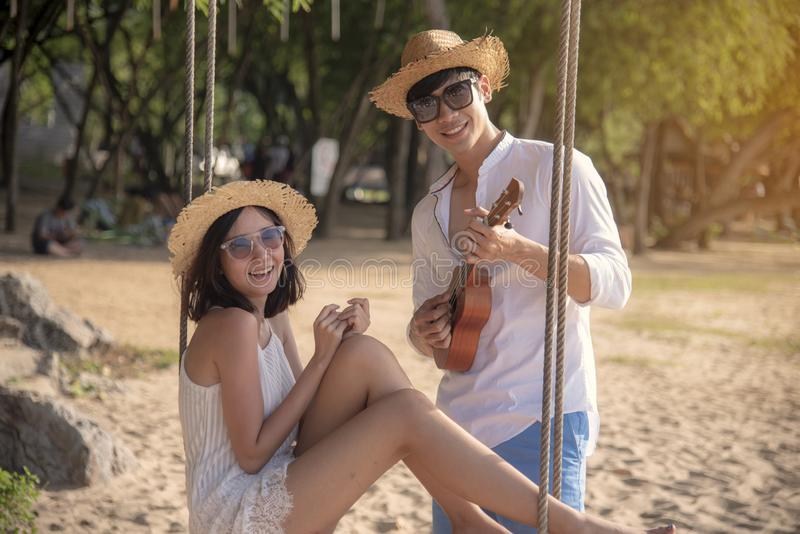 Happy young honeymoon couple on beach having vacation fun at paradise tropical island beach on sunny day. Young couple relax on. White sand beach. Couple in stock photos