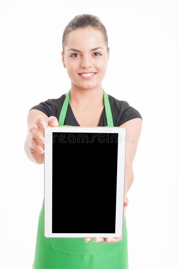 Happy young hypermarket seller holding modern tablet. With blank screen and text area isolated on white stock image
