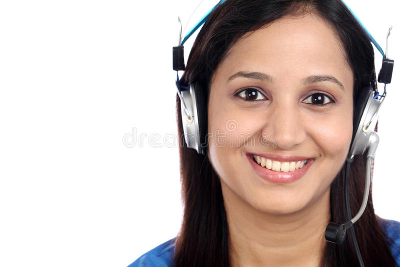 Happy young Indian call center girl. Against white background royalty free stock photography
