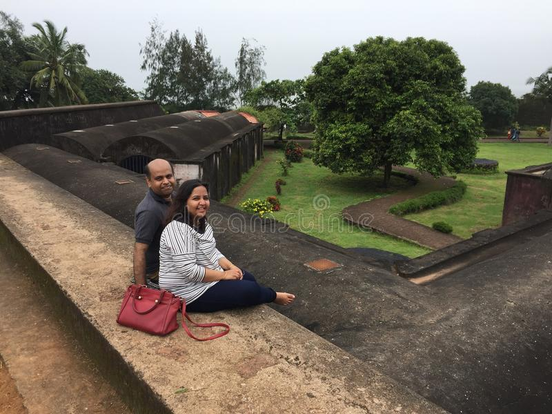 A young Indian couple posing at St. Angelo's Fort, Kunoor royalty free stock photography