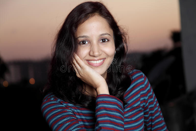 Happy young Indian woman stock images