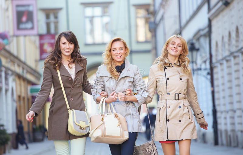 Happy young ladies in the old town royalty free stock photos