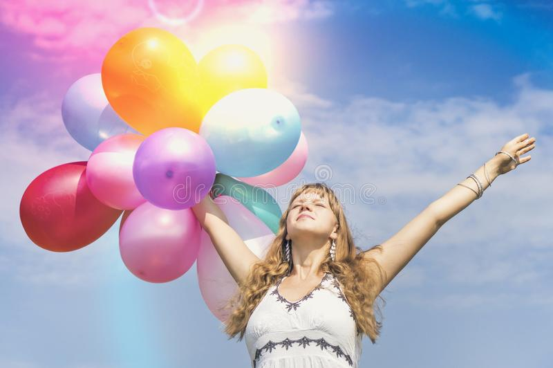 Happy young lady celebrates birthday with balloons stock images