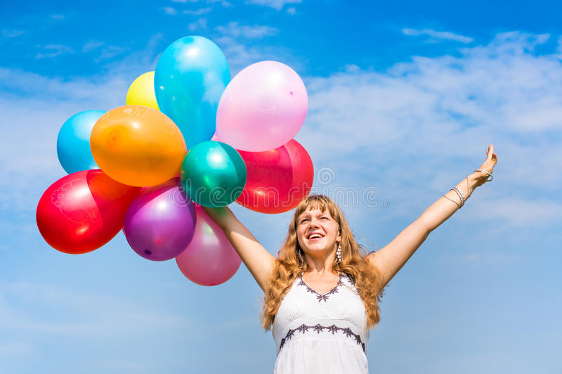 Happy young lady celebrates birthday with balloons. Happy young lady celebrates birthday and playing with balloons stock images