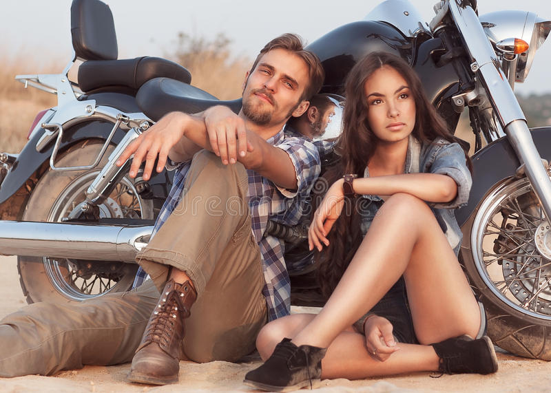 Happy young love couple on scooter stock images