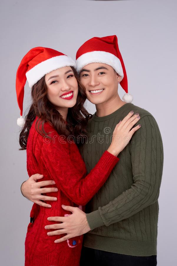 Happy young lovers in knitted woolen clothing hugging and looking together stock photos