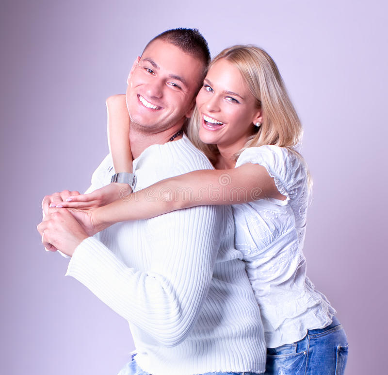 Happy Young loving couple hugging royalty free stock image