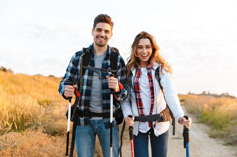 Happy young loving couple outside with backpack in free alternative vacation camping. Photo of happy young loving couple outside with backpack in free stock image