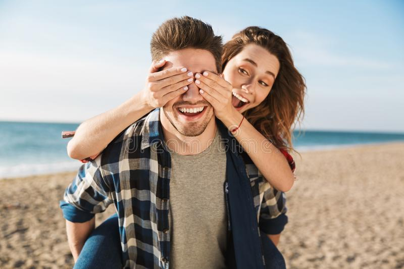 Happy young loving couple outside in free alternative vacation camping. Photo of happy young loving couple outside in free alternative vacation camping hugging stock image