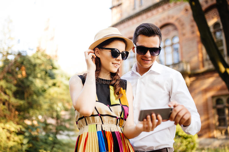Happy young loving couple standing outdoors stock photo