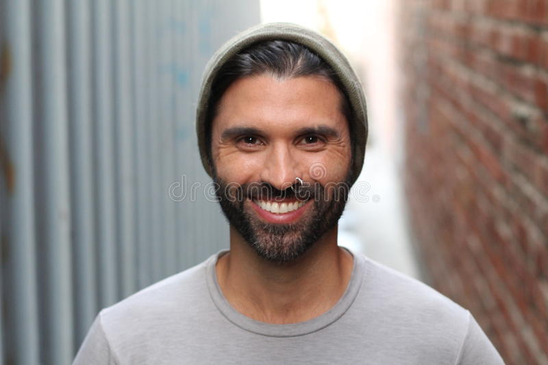 Happy young male with beanie and piercing.  stock image