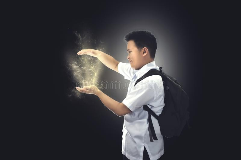 Student showing something in pixie dusts. royalty free stock photo