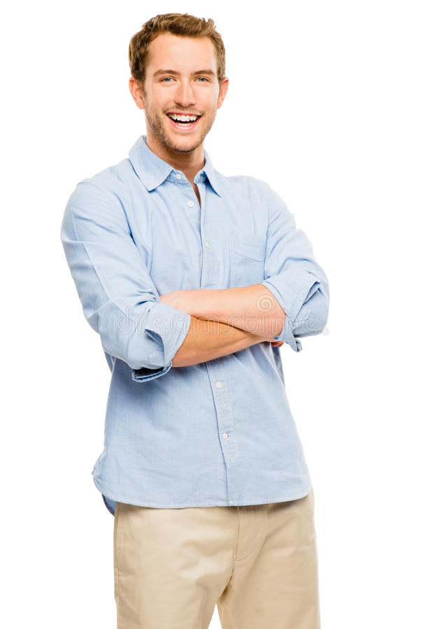Happy young man arms folded smiling on white background. Happy attractive young man in casual clothing arms folded royalty free stock photography