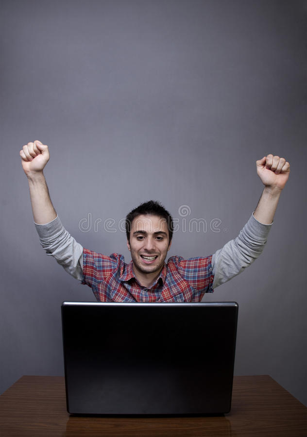 Download Happy Young Man With Arms Raised Stock Image - Image of sitting, computer: 24646589