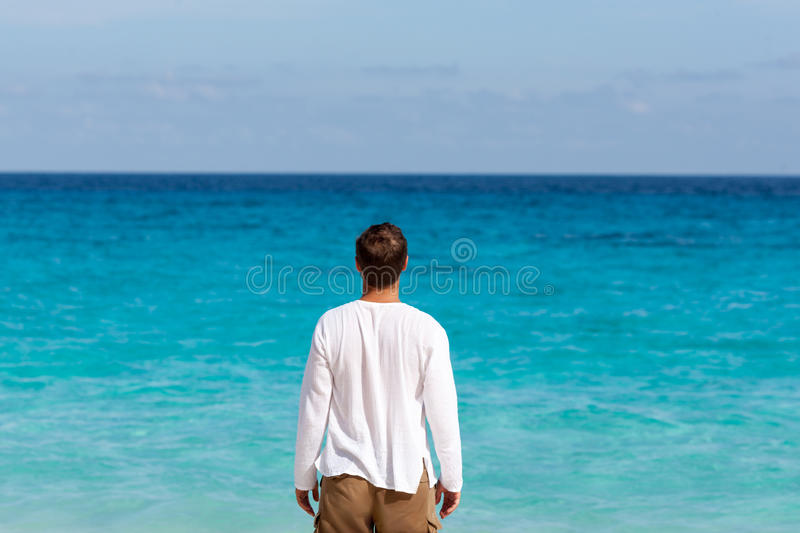 Happy young man on the beach royalty free stock photos