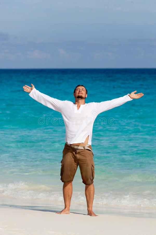 Happy young man on the beach stock photography