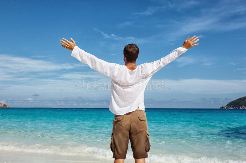 Happy young man on the beach stock photos