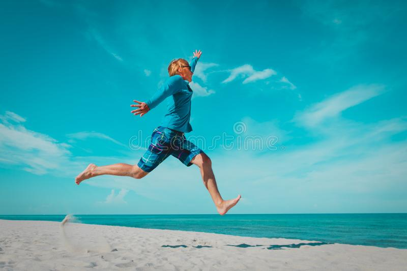 Happy young man on beach vacation, enjoy sea stock photo