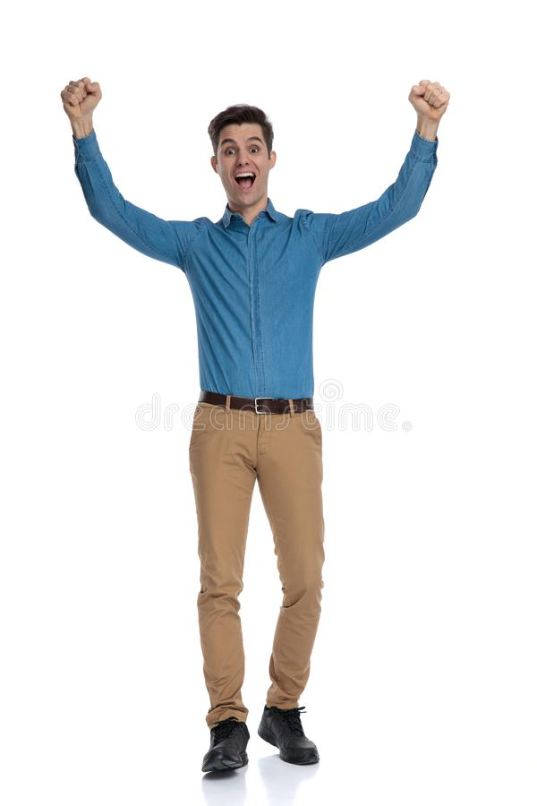Happy young man screaming and celebrating victory stock image
