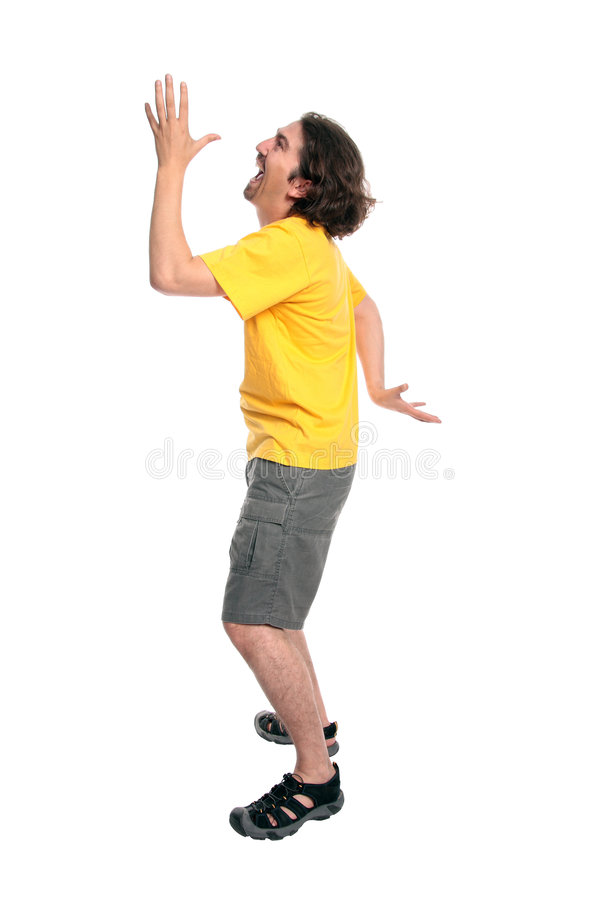 Happy young man dancing. Walking like an egiptian - isolated onnwhite royalty free stock photo