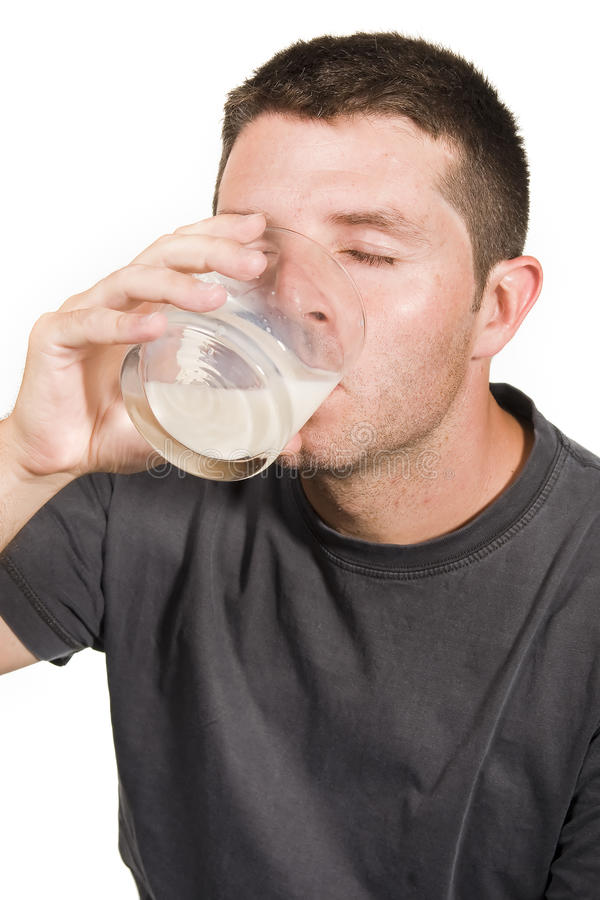 Happy Young  Man Drinking Milk Royalty Free Stock Photos