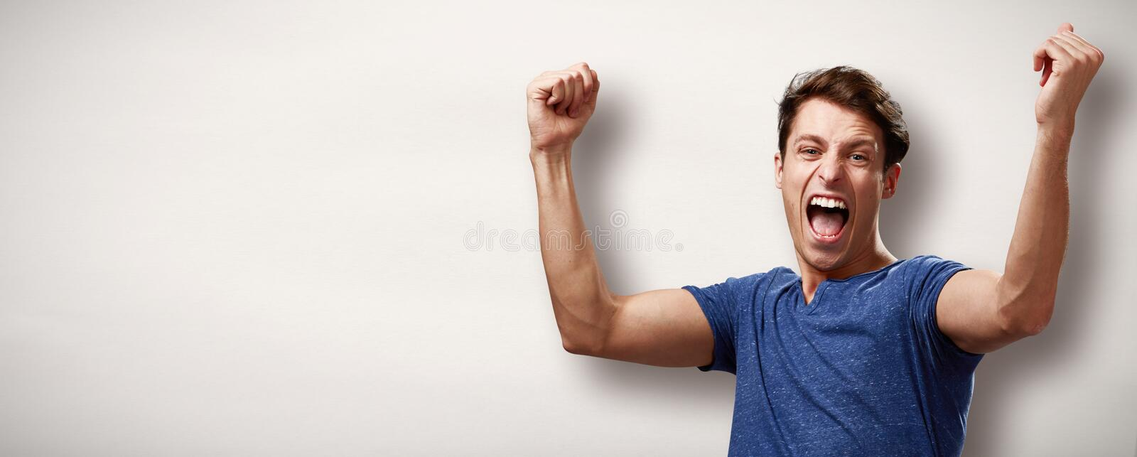 Happy young man. Happy excited laughing winner young man face expression royalty free stock photos