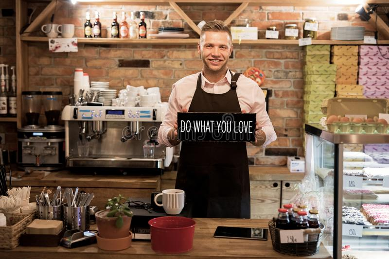 Happy young man has started his own business stock photography