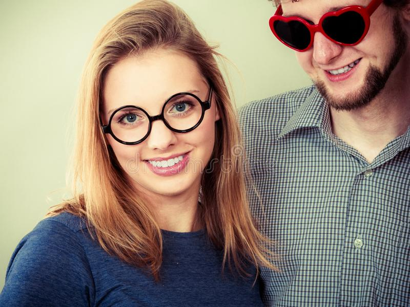 Happy couple man and woman in glasses stock photo
