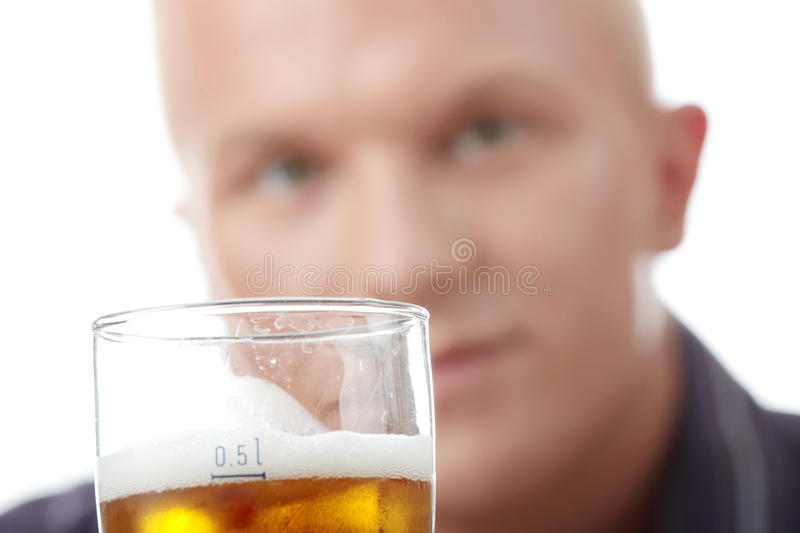 Happy young man holding a glass of beer stock photo