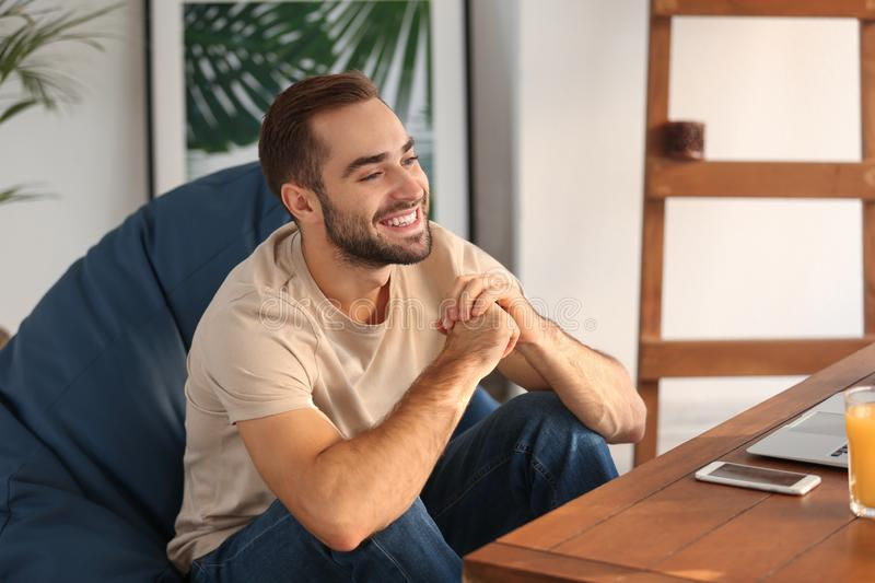 Happy young man at home royalty free stock photography