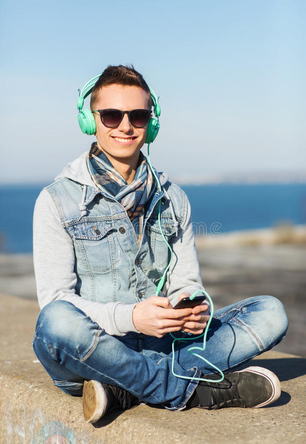 Free Happy Young Man In Headphones With Smartphone Stock Images - 64871424