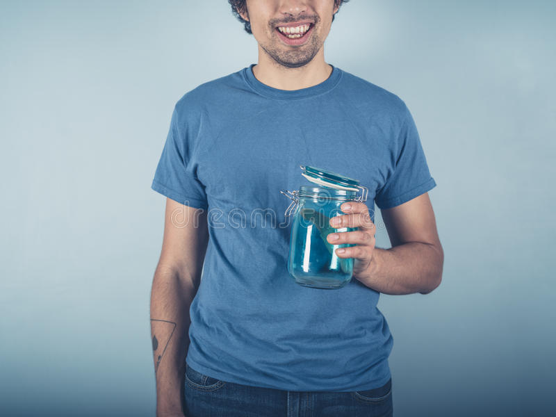 Happy young man with jam jar royalty free stock images