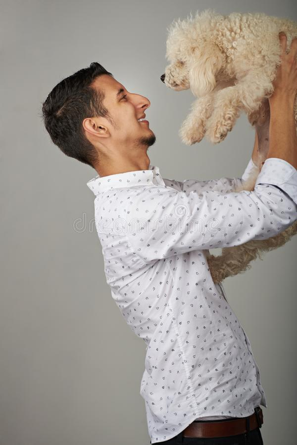 Happy young man with dog royalty free stock photography