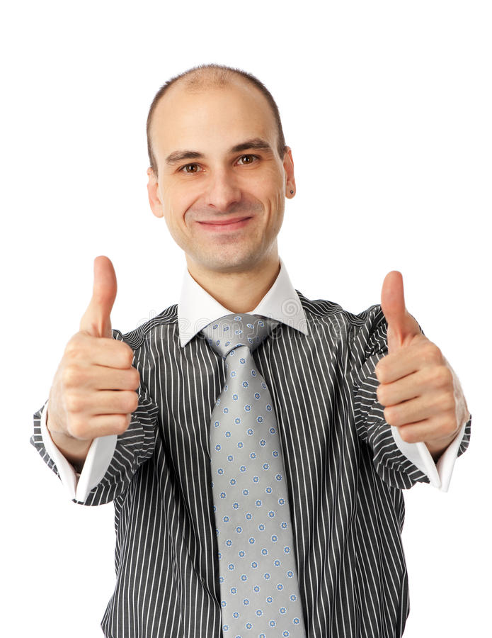Happy young man showing thumb up and smiling royalty free stock images