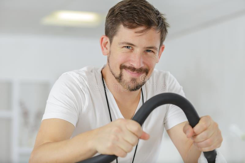 Happy young man after spinning class royalty free stock image