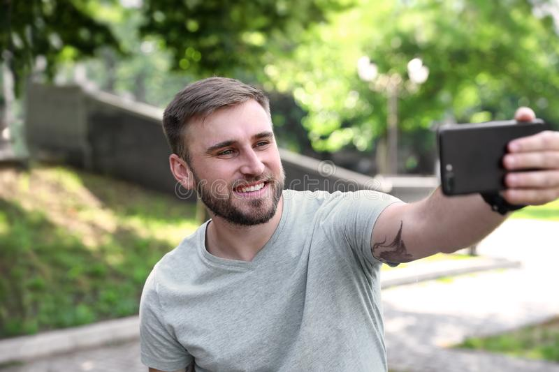 Happy young man taking selfie royalty free stock photo