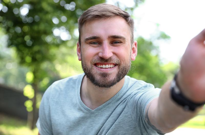 Happy young man taking selfie royalty free stock photos